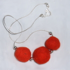Felted_wool_necklace_orange_triplet_1gs_(2015_01_30_23_39_14_utc)